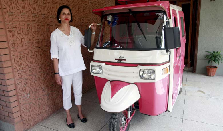 Zar Aslam poses with her own rickshaw. Photo taken from The Malaysian Insider