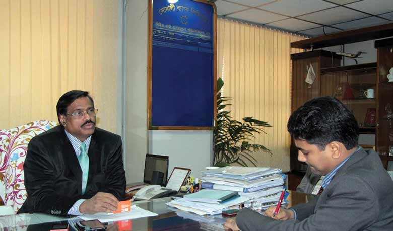 risingbd.com staff correspondent Niaz Mahmud Sohel taking interview of Sonali Bank MD Pradip Kumar Dutta (L)