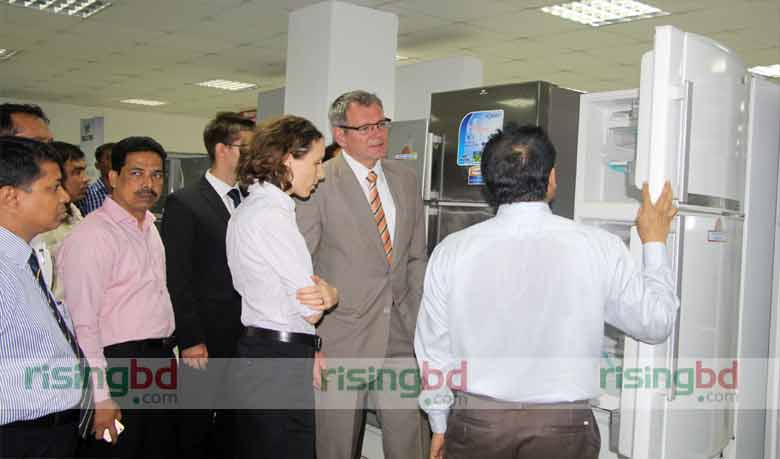 Walton Managing Director Ashraful Alam shows German ambassador the newly designed refrigerator, which will be produced at the newly set up factory unit at Walton Hi-Tech Industries at Chandra in Gazipur on Thursday.