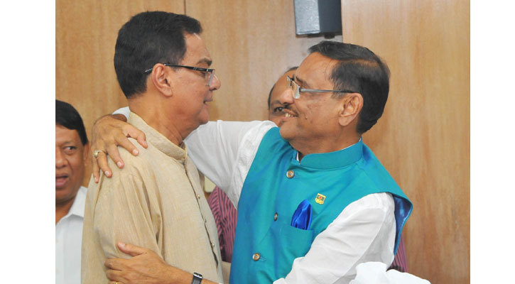 Newly elected General Secretary of Awami League Obaidul Quader embracing with former General Secretary of the party Syed Ashraful Islam.