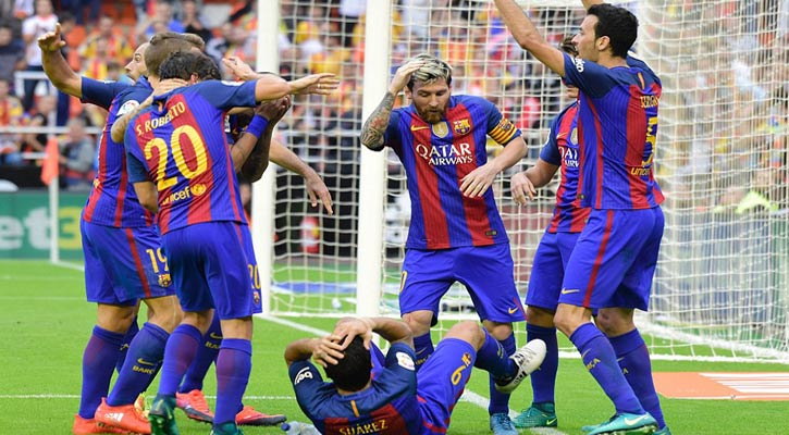 Barcelona`s Argetinian forward Lionel Messi (C) and teammates react.