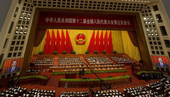 China cuts growth target, expects 6.5% this year