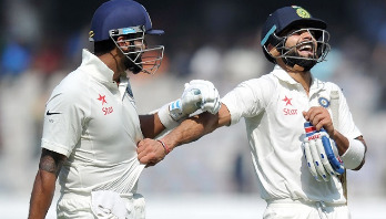 Kohli, Vijay make Day 1 for India