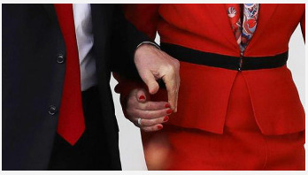 Trump holds Theresa May's hand during walkabou