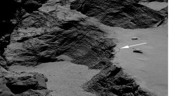 Rosetta comet orbiter films deep-space landslide