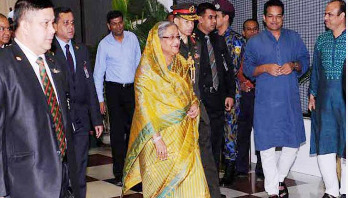 PM returns home from Austria