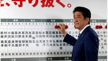Japan PM promises to deal with North Korea threat