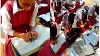 যে স্কুলের শিক্ষার্থীরা দুই হাতে লেখে