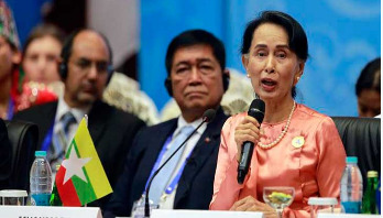Suu Kyi blames world conflicts on illegal immigration