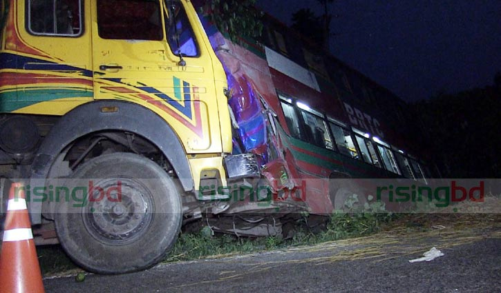 Six killed after truck smashes into parked bus