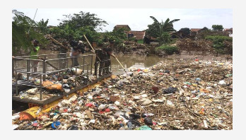 Giant plastic berg blocks Indonesian river