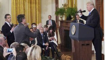 CNN sues Trump, White House aides