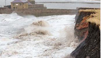 Rising seas will swamp homes, report says