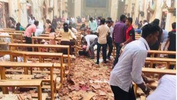 At least 138 dead as multiple blasts hit Sri Lanka churches