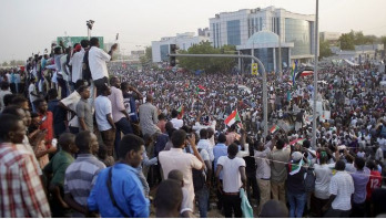 Sudan protesters defy curfew after military ousts Bashir