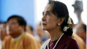 Suu Kyi to defend national interest in Hague