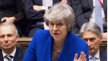 Theresa May survives no-confidence vote