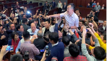 Hong Kong lawmakers scuffle in parliament