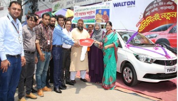 School teacher gets new car buying Walton fridge