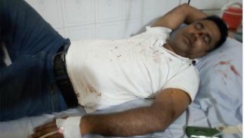 হিলিতে সন্ত্রাসী হামলায় সিনিয়র সাংবাদিক আহত