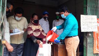 বান্দরবানে ১০ টাকা দরে চাল বিক্রি শুরু